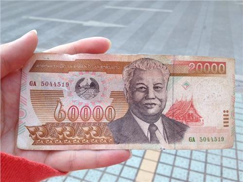 老挝币兑人民币_老挝币对人民币汇率剧情介绍